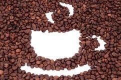 Koppen som göras av kaffebönor Arkivbild