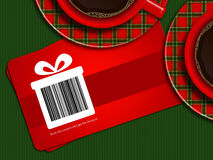 Koppen van koffie met de coupons van de Kerstmisverkoop op tafelkleed Stock Foto's