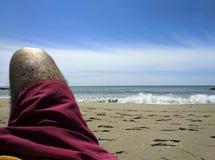 koppla av för strand Arkivfoto