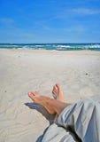 Koppla av på stranden Arkivbild