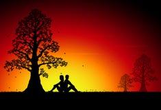 Koppla ihop i solnedgång Fotografering för Bildbyråer