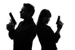 Koppla ihop silhouetten för brottslingen för medlet för kvinnamanen den detektiv- hemliga Fotografering för Bildbyråer