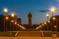 Koptug academician monument in Novosibirsk. At evening with nice citylights Stock Image