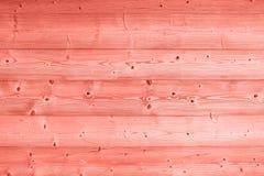 Korallrosa färger tonade tappningträplankabakgrund arkivfoton
