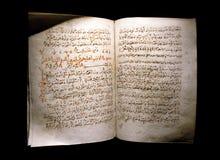 Koran on a black background Stock Photography