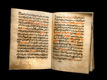 Koran on a black background Stock Image