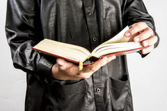 Koran in hand - holy book of Muslims ( public item of all muslims ).  Stock Image