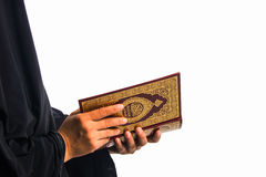 Koran in hand - holy book of Muslims( public item of all muslims )Koran in hand  muslims  woman. Koran in hand - holy book of Muslims . ( public item of all Royalty Free Stock Image