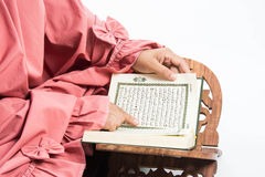 Koran in hand - holy book of Muslims( public item of all muslims )Koran in hand  muslims  woman. Koran in hand - holy book of Muslims . ( public item of all Royalty Free Stock Photo