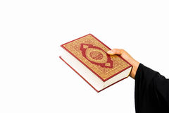Koran in hand - holy book of Muslims women ( public item of all muslims ) Stock Images