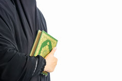 Koran in hand - holy book of Muslims women ( public item of all muslims ) Stock Image