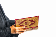Koran in hand - holy book of Muslims women ( public item of all muslims ). Koran in hand - holy book of Muslims women .   public item of all muslims Royalty Free Stock Images