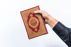 Koran in hand ,Quran in hand  - holy book of Muslims , on white background Royalty Free Stock Image