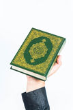 Koran in hand ,Quran in hand  - holy book of Muslims , on white background.  Stock Images