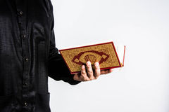 Koran in hand ,Quran in hand  - holy book of Muslims , on white background Royalty Free Stock Photos