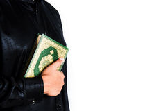 Koran in hand ,Quran in hand  - holy book of Muslims , on white background Stock Photography