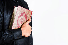 Koran in hand ,Quran in hand  - holy book of Muslims , on white background.  Royalty Free Stock Photography