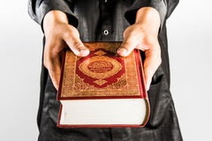 Koran in hand ,Quran in hand  - holy book of Muslims , on white background.  Royalty Free Stock Image