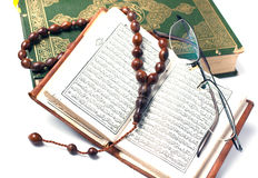 Koran, holy book stock images