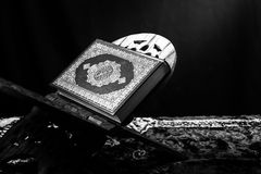 Koran - holy book of Muslims,ฺblack and white  style filtered photo.  Royalty Free Stock Photo