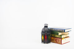 Koran holy book of Muslims with lightened Lantern style Arab or Morocco.  Royalty Free Stock Image