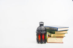 Koran holy book of Muslims with lightened Lantern style Arab or Morocco.  Royalty Free Stock Images