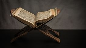 Koran - holy book of Muslims  public item of all muslims. On the table , still life Stock Photography