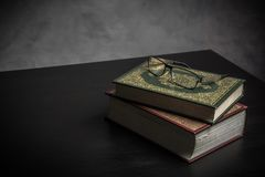 Koran - holy book of Muslims  public item of all muslims. On the table , still life Stock Images
