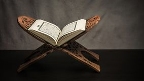 Koran - holy book of Muslims  public item of all muslims  on t. He table , still life Royalty Free Stock Photos
