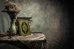 Koran - holy book of Muslims  public item of all muslims. Koran - holy book of Muslims  public item of all muslims  on the table , still life Stock Photo