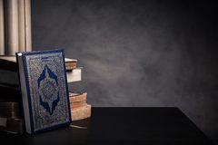 Koran - holy book of Muslims  public item of all muslims. On the table , still life Royalty Free Stock Image