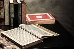 Koran - holy book of Muslims  public item of all muslims. On the table , still life Royalty Free Stock Photo