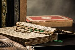 Koran - holy book of Muslims  public item of all muslims. Koran - holy book of Muslims  public item of all muslims  on the table , still life Stock Images