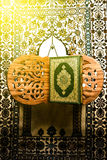 Koran - holy book of Muslims, sunlight effect filter.  Stock Image