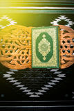 Koran - holy book of Muslims, sunlight effect filter.  Royalty Free Stock Image