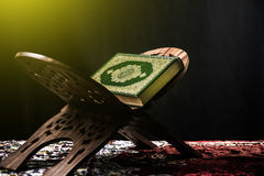 Koran - holy book of Muslims, sunlight effect filter.  Royalty Free Stock Photo