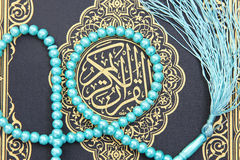 Koran holy book with rosary Royalty Free Stock Photography