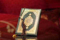 Koran holy book with rosary. Koran or quran, holy book of Islam religion royalty free stock photo