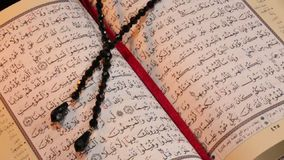 The Koran - Islamic Holy Text. The Holy Koran or Quran is the central religious text of Islam, which Muslims believe to be a revelation from God. Quranic stock video