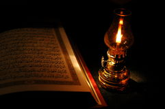 Koran and the lantern. Muslim's Holy Koran and a classical kerosene lantern Stock Photos