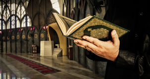 Koran with muslims man . Mosque background . Koran - holy book of Muslims.  Royalty Free Stock Images