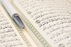 Koran and pen Royalty Free Stock Images