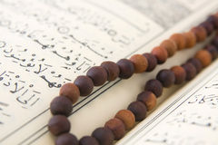 Koran and prayer beads Stock Photo