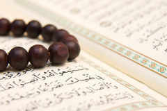 Koran and prayer beads Royalty Free Stock Photo