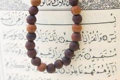 Koran Quran and rosary Stock Photos