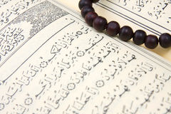 Koran and rosary Stock Photos