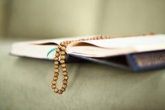 Koran with rosary beads Royalty Free Stock Photos