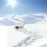 Koran at snow in mountain Stock Photos