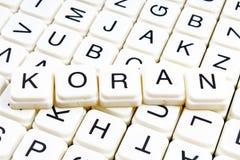 Koran text word crossword. Alphabet letter blocks game texture background. White alphabetical cubes blocks letters on. Crossword letters educational toy Stock Images