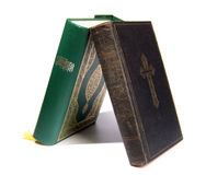 Koran vs Bible. Bible and Koran leaning on each other (Small DOF stock photography
